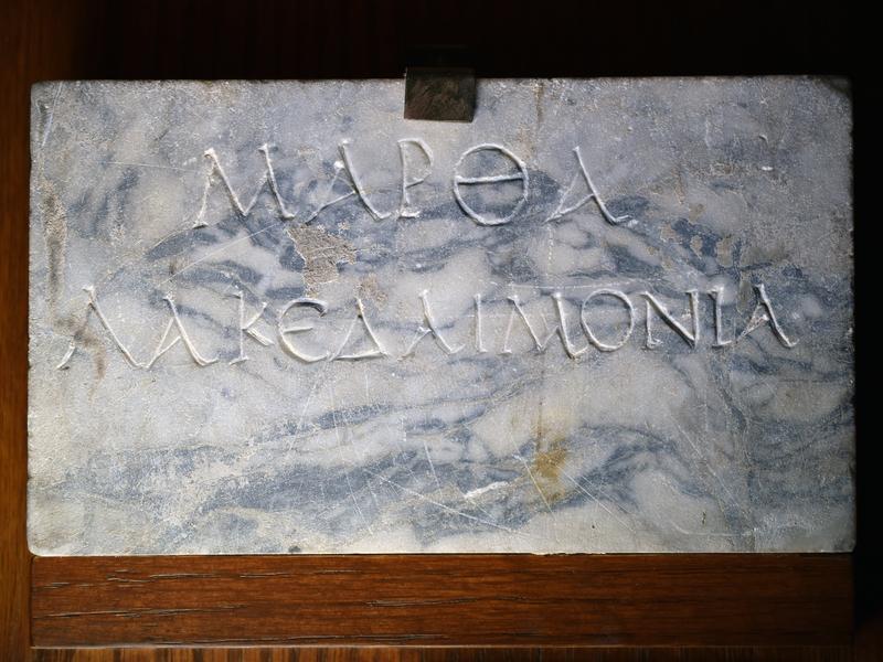 Plain columbarium tablet of mottled gray pavonazzetto.