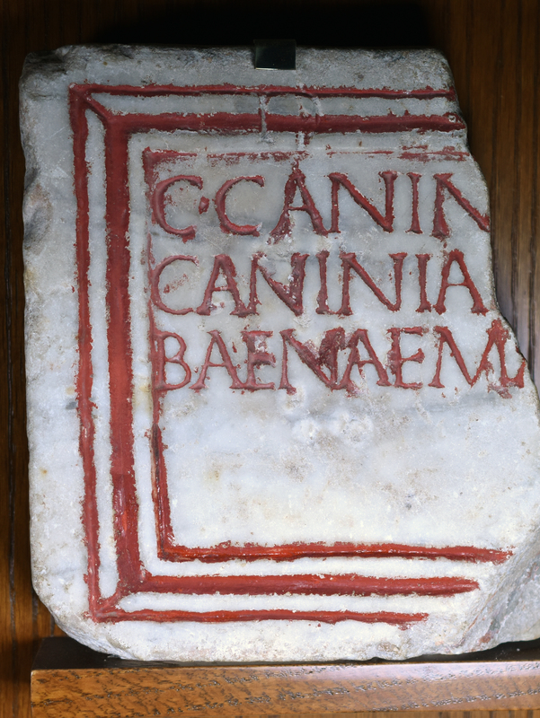 Fragmentary white marble plaque, said to be from Porta Salaria, Rome (purchased in 1909); rubricated inscription bordered by three rubricated lines which pass through the (uncompleted) D [M].