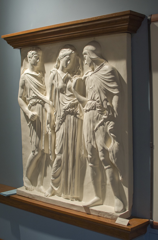 "The Orpheus Relief in the Wilcox belongs to a class of so-called ""three figure reliefs"" in Classical (5th c. B.C. Greek) style. Most of these, however, have been found at sites in Italy, and thus may have been produced by Greek artists for an Italian art market in the 1st c. B.C. or 1st c. A.D. Five full copies and two partial ones are known; our cast is of the relief in the Naples Archaeological Museum, Italy. Inventory no. 6727. Marble. H. 1.18 m. (3 ft.)