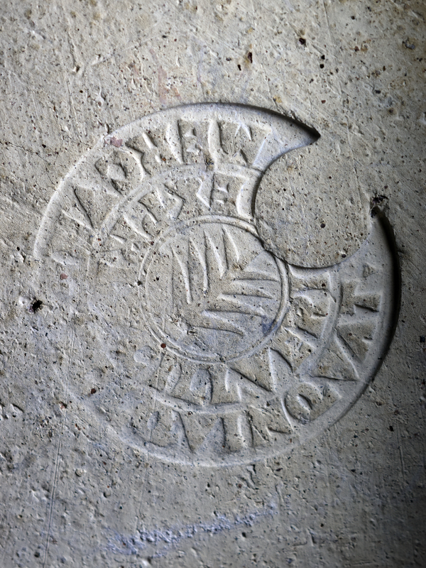 Stamped brick from Italy (1st half of 2nd c CE). Originally square fragment (see Lind pl. 49J), now broken in half. Large circular stamp with small palm branch in the center; around it are two rows of quadrate letters.